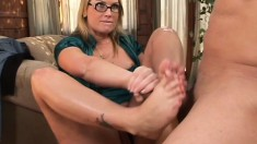 Playful blonde with sexy legs has amazing blowjob and footjob skills