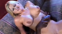 Buxom blonde Staci Thorn has a huge black prick deeply exploring her juicy holes