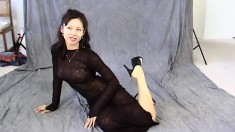 Maya Chung has on her sexy see-through dress while she poses