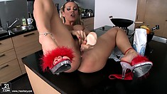 Now Sandy is blonde and fingering her twat and using a big dildo