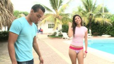 Curvaceous Latina beauty has a guy pounding her juicy cunt by the pool