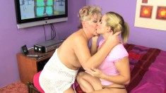 Cute blonde with pigtails gets her pussy licked by a mature lesbian