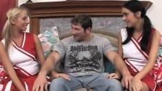 Wild cheerleaders Ashley and Stephanie take turns on a throbbing cock
