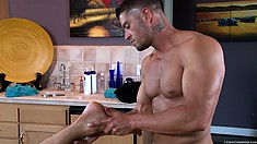Master masseur works a hot buff guy from his head to his toes