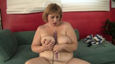 Huge breasted mature drills her aching holes with her favorite sex toy