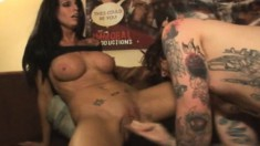 Tattooed guy has a big breasted brunette bouncing on his raging dick