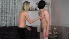 Skinny Blonde Gives Her Masked Boyfriend A Nice And Sexy Footjob