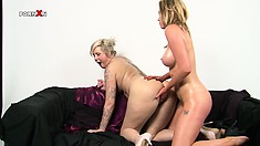 Holly is fond of stuffing beautiful Mandy's wet and tasty cunny