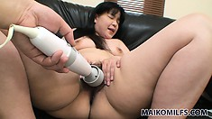 Her curvy body trembles with pleasure as he pleases her hairy snatch with sex toys