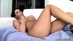 Brunette pornstar Rachel Starr masturbates on the sofa, showing off for a younger guy