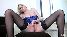 Blonde In A Tight Blue Corset And Stockings Gives Herself A Rub