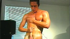 Oiled up hunk Mac Sabre polishes his meaty rod until he cums