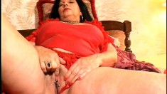 Chunky mature woman plays with her nipples and fingers her needy twat