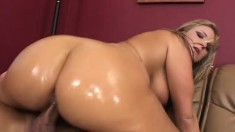 With her body all oiled up, the curvy blonde gets her ass banged hard