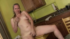 Curvy blonde milf Catherine gets naked and masturbates in the kitchen