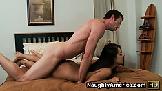 Long-haired brunette with a sexy tan rides on a bareback cock