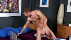 Handsome hunk Alexi Auclair takes off his striped boxers to masturbate on webcam