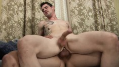 Beautiful tattooed guy works his hot lips and his tight ass on a cock