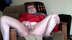 Old and horny granny using a dildo to masturbate