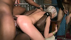 Taking big black boners in all her holes at once, this blonde is a gangsta