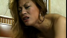 Sexy Oriental cougar with big tits Aya wildly fucks a long white cock on the bed